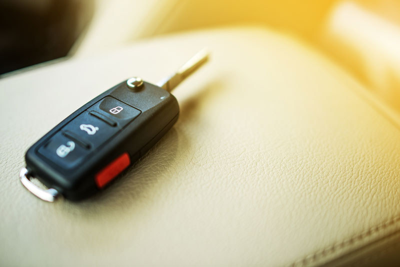 a car key inside the car on the seat