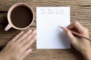 someone writing a to do list