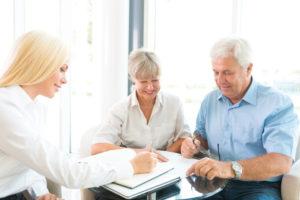 two seniors talking to an insurer