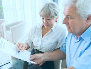 Older Couple looking at policy